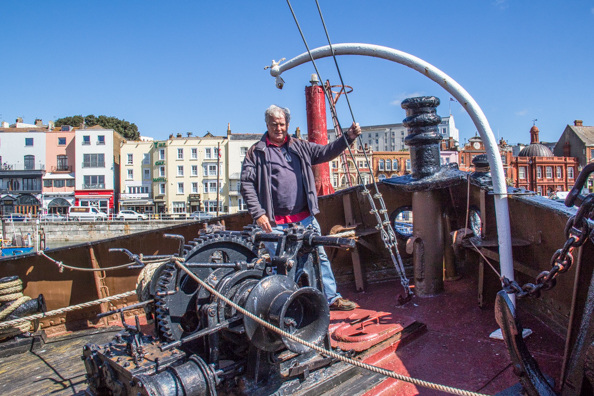 Michael on the steam tug Cervia in the Royal Harbour at Ramsgate, Thanet, Kent