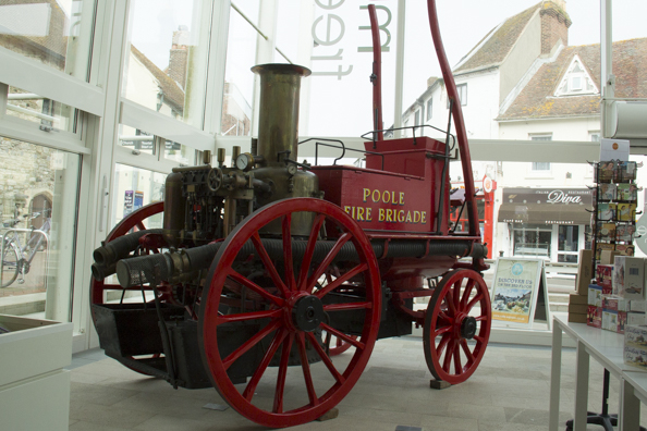 Old fire engine in the entance to Poole Museum on Poole Quay-7972