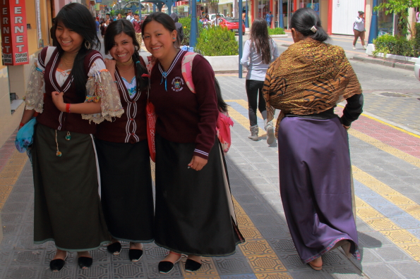 Schoolgirls in traditional school uniforms in Otavalo Ecuador